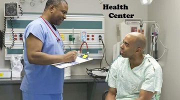 Black doctor questioning patient in hospital