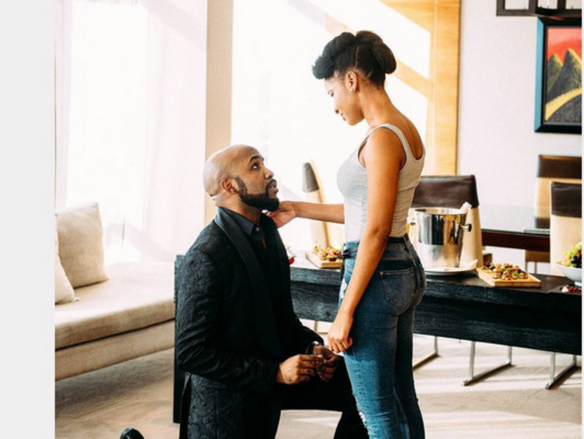 Veteran bachelor Banky W is off the market! Singer proposes to co-star Adesua Etomi