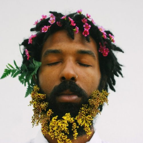FLOWERS ON HIS HEAD