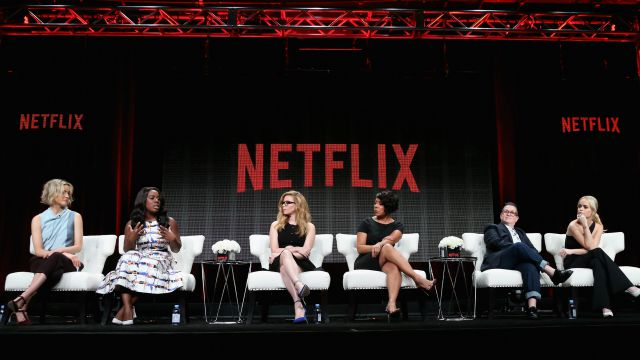 """(L-R) Actors Taylor Schilling, Uzo Aduba, Natasha Lyonne, Selenis Leyva, Lea DeLaria and Taryn Manning speak onstage during the """"Orange Is the New Black"""" panel discussion at the Netflix portion of the 2015 Summer TCA Tour at The Beverly Hilton Hotel on July 28, 2015 in Beverly Hills, California."""